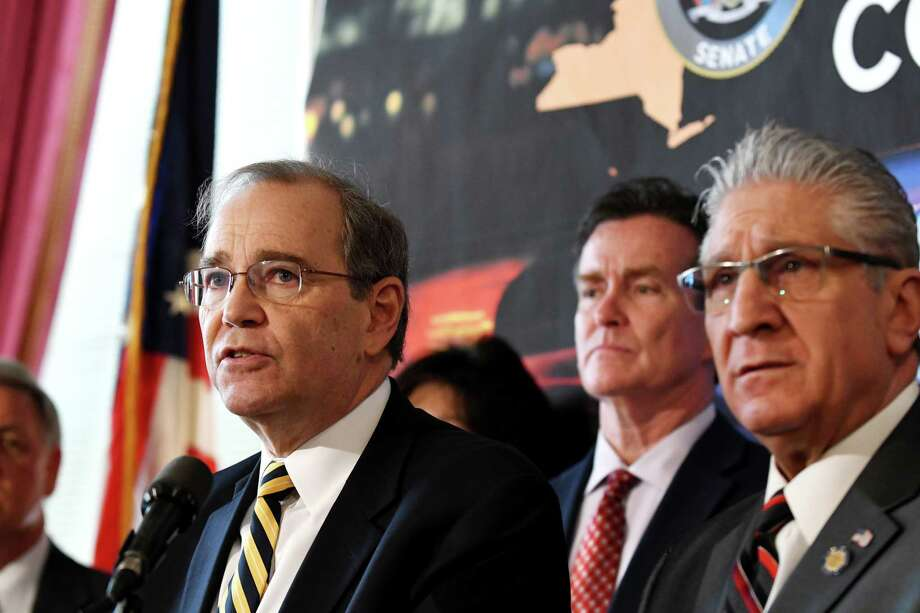 Schenectady County District Attorney Robert Carney, left, is joined by Senate Republican Leader John Flanagan, center, and Sen. James Tedisco, right, during a press conference where they addressed the downside of proposed criminal justice reform measures on Wednesday, March 6, 2019, at the Capitol in Albany, N.Y. (Will Waldron/Times Union) Photo: Will Waldron, Albany Times Union / 40046378A