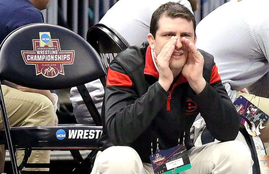SIUE wrestling coach Jeremy Spates shouts instructions at last year's NCAA Wrestling Championships in Cleveland. It was announced this week that the Mid American Conference, of which SIUE is a member, will add seven new affiliate members. Photo: SIUE Athletics
