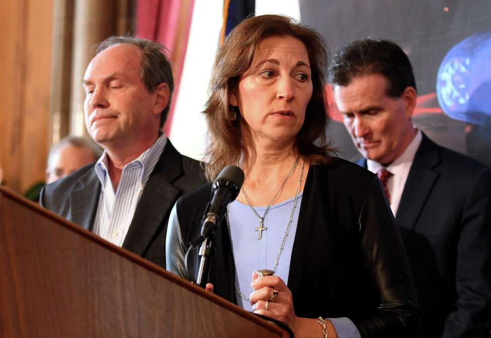 Michael, left, and Regina Stewart, parents of Christopher Stewart, a Shenendehowa high school student who was killed by a drunk and drugged driver, joined Senate Republican Leader John J. Flanagan, right, during a press conference where they addressed the downside of proposed criminal justice reform measures on Wednesday, March 6, 2019, at the Capitol in Albany, N.Y. (Will Waldron/Times Union)
