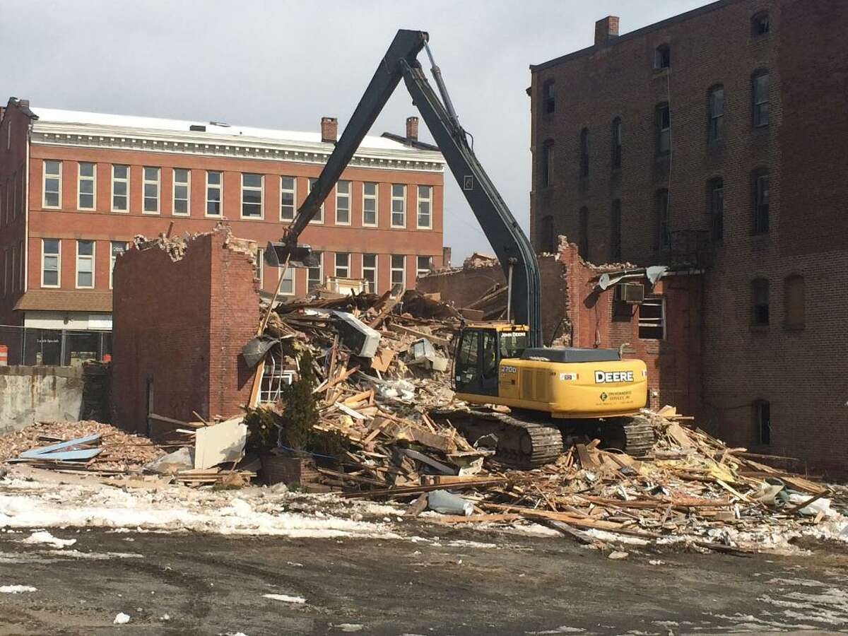 Demolition begins in downtown Derby on the four vacant buildings remaining on Main Street/Rte. 34. The state will begin expanding the road into four lanes next spring.
