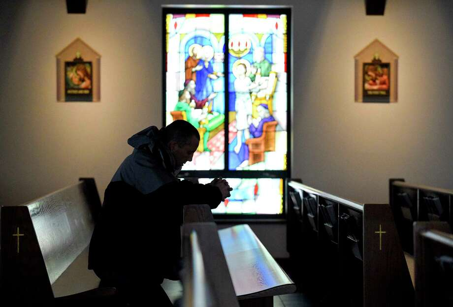 A worshiper prays during an Ash Wednesday Service at the Church of the Holy Spirit on March 6, 2019 in North Stamford, Connecticut. Photo: Matthew Brown, Hearst Connecticut Media / Stamford Advocate