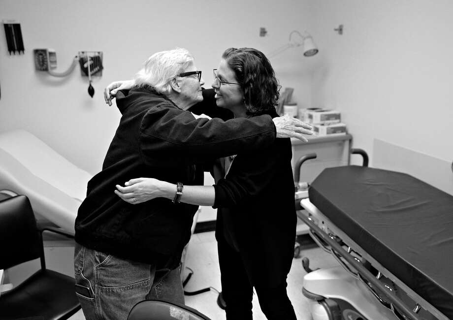 Dr. Margot Kushel, hugs patient Shawn Martin who is homeless and about to turn 75, after a brief meeting at Zuckerberg San Francisco General Hospital and Trauma Center in San Francisco, Calif., on Tuesday, February 5, 2019. Kushel is the Professor of Medicine and Director of the UCSF of the Center for Vulnerable Populations, and is leading a UCSF research team that has been studying a group of older homeless people for several years and has found that nearly half of them became homeless for the first time ever when they were over 50 years old. This shows two things. One, the ravishing effect of the current economy on older poor people, which is what they were before becoming homeless. And two, it sends a warning signal to homeless policy planners that the shelters and housing facilities of the near future will have to beef up on medical services for these older homeless people, because after they hit the street they have a lot more ailments than younger street people. Photo: Carlos Avila Gonzalez / The Chronicle