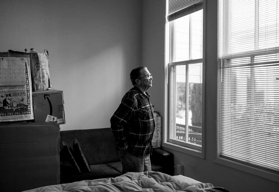 Wayne Shannon, 74, looks out his bedroom window at the Altenheim senior living facility in Oakland, Calif. Monday, Feb. 18, 2019. Photo: Jessica Christian / The Chronicle
