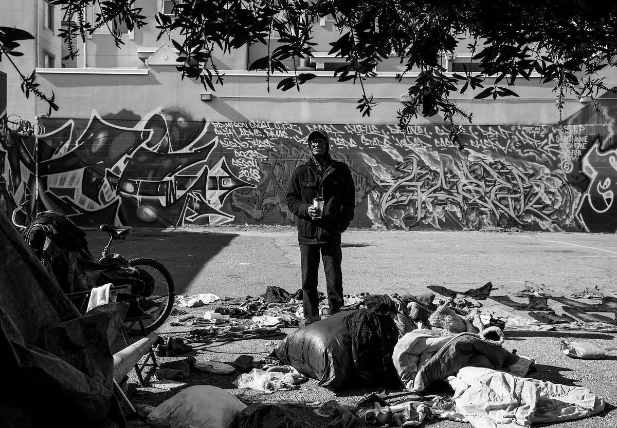 Joe White, 68, a homeless man for the past 6 years, stands near his long-time encampment near 13th and Alice streets as he cleans up before moving into transitional housing at the Holland Hotel in Oakland, Calif. Thursday, Feb. 7, 2019.