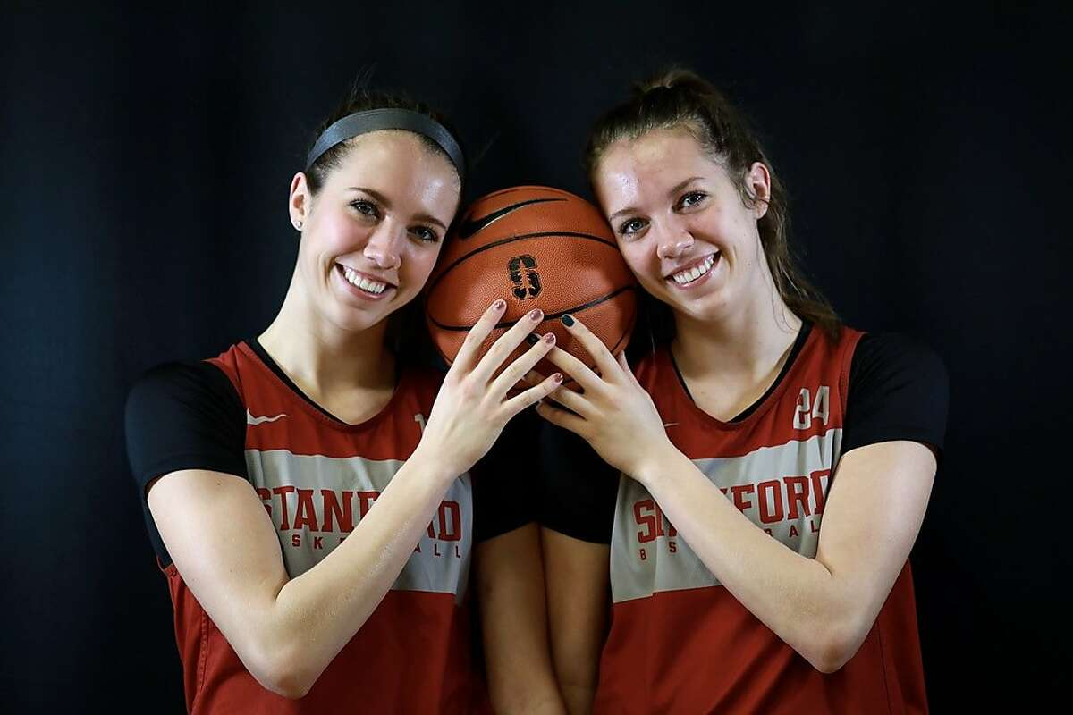 Twins Lexie (12) and Lacie Hull (24) pose for a portrait at Maples Pavilion at Stanford University in Stanford, Calif., on Tuesday, March 5, 2019. The sisters, of Spokane, Wash., are guards for Stanford University's women's basketball team. They have made great strides as Stanford freshmen and will be key members of the rotation as the Cardinals play their first game in the Pac-12 tournament on Friday.