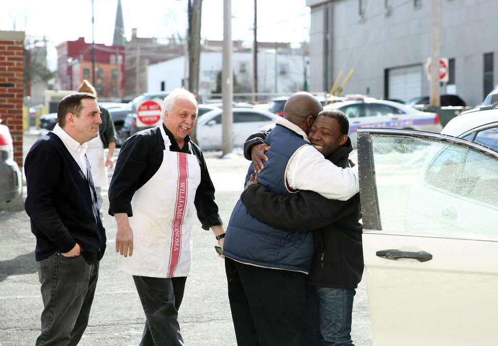 Kinimo Ngoran, chef at the Capital City Rescue Mission, is overcome with emotion as he is greeted by friends, family and co-workers after being released from ICE detention on Wednesday, March 6, 2019 at the Capital City Rescue Mission in Albany, NY. (Phoebe Sheehan/Times Union)