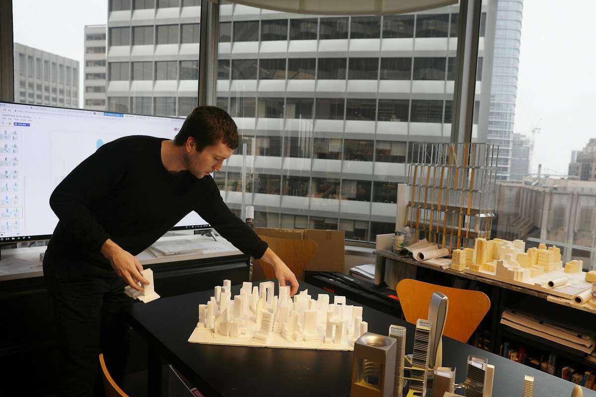 Edwin O'Brien, architechtural designer Skidmore, Owings & Merrill, arranges a group of first generation study models being displayed at Skidmore, Owings & Merrill, on Wednesday, March 6, 2019 in San Francisco, Calif.