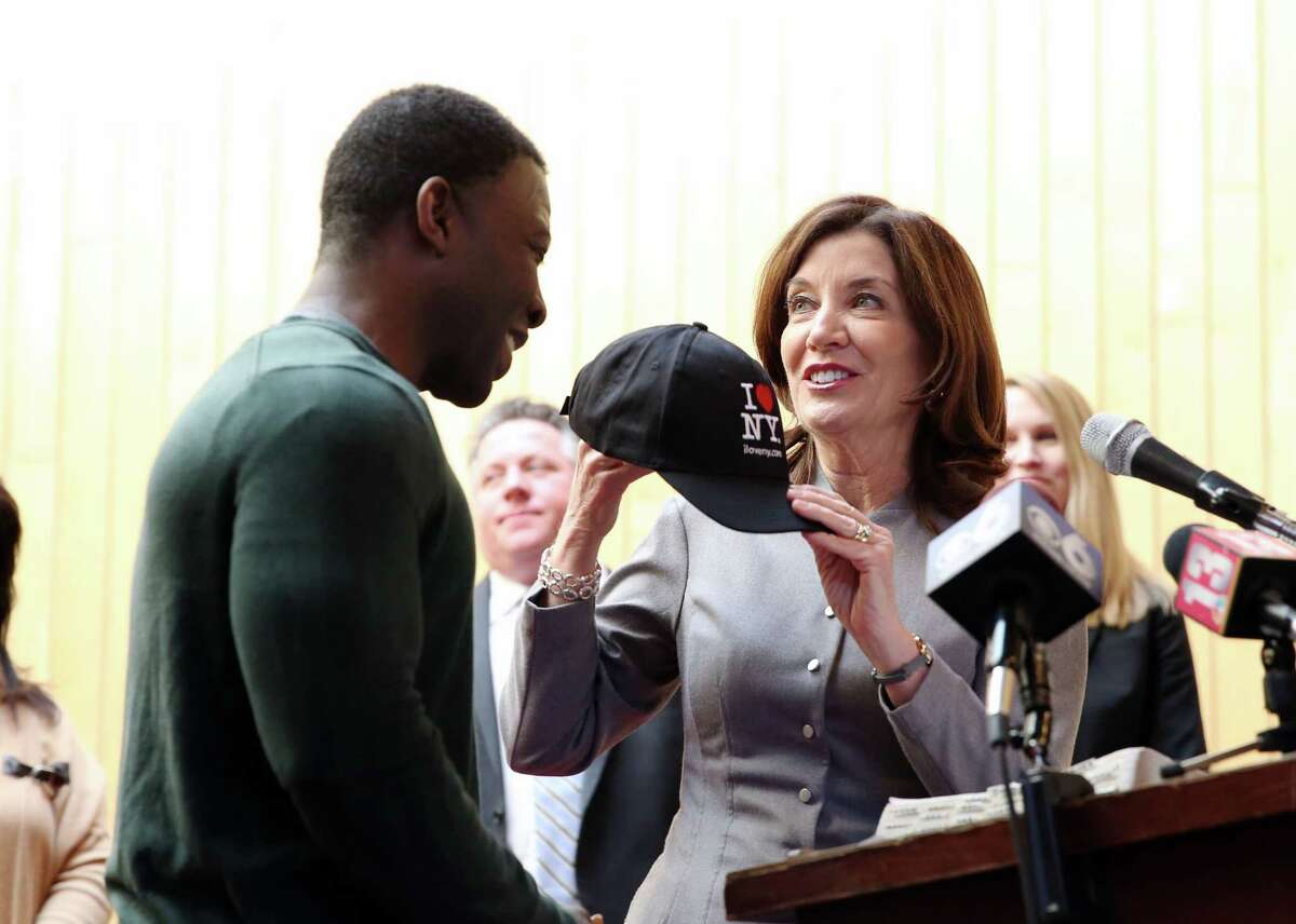 Lieutenant Governor of New York Kathy Hochul gives Kinimo Ngoran, chef at the Capital City Rescue Mission, an 'I love NY' hat after being released from ICE detention in Buffalo on Wednesday, March 6, 2019 at the Capital City Rescue Mission in Albany, NY. (Phoebe Sheehan/Times Union)