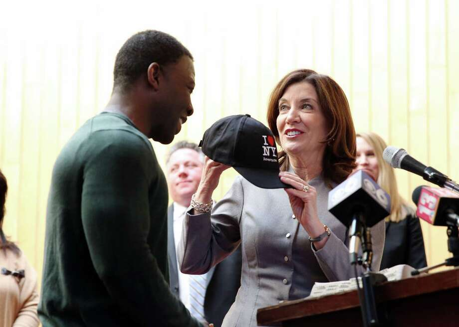 Lieutenant Governor of New York Kathy Hochul gives Kinimo Ngoran, chef at the Capital City Rescue Mission, an 'I love NY' hat after being released from ICE detention in Buffalo on Wednesday, March 6, 2019 at the Capital City Rescue Mission in Albany, NY. (Phoebe Sheehan/Times Union) Photo: Phoebe Sheehan, Albany Times Union / 40046377A