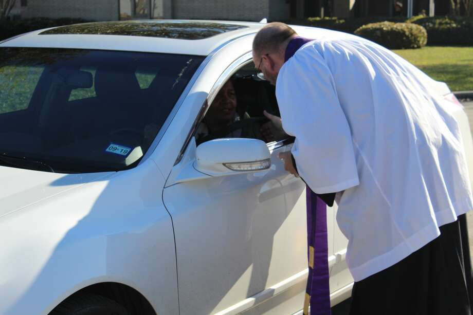 Residents in the Port Neches area stopped by the Holy Trinity Episcopal Church Wednesday morning for the 'Ashes to Go' Event. Photo: Photo By Erica Apodaca/The Enterprise