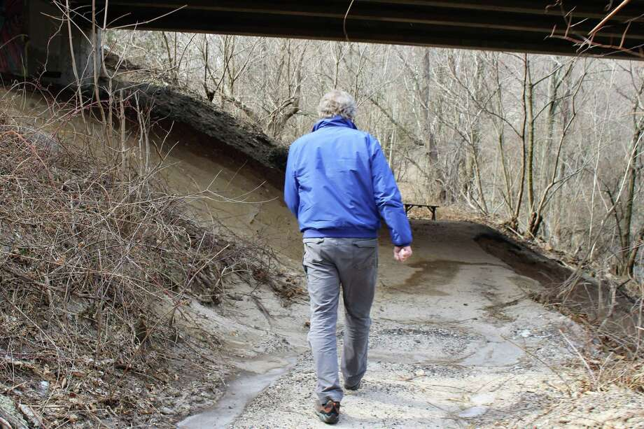 "Charlie Taney, executive director of the Norwalk River Valley Trail, walks part of the ""missing link"" of the Norwalk River Valley Trail on Wednesday, February 27, 2019. Photo: Kelly Kultys / Hearst Connecticut Media"