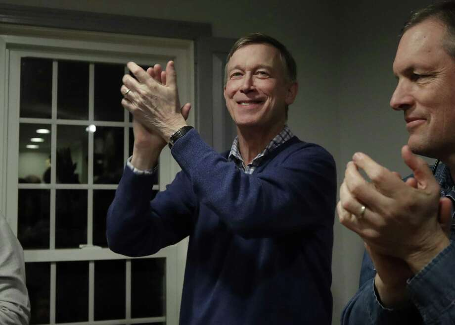 Former Colorado Gov. and Middletown resident John Hickenlooper, left, applauds at a campaign house party Feb. 13 in Manchester, N.H. Hickenlooper declared he's running for the Democratic presidential candidacy Monday. Photo: Elise Amendola / Associated Press / Copyright 2019 The Associated Press. All rights reserved