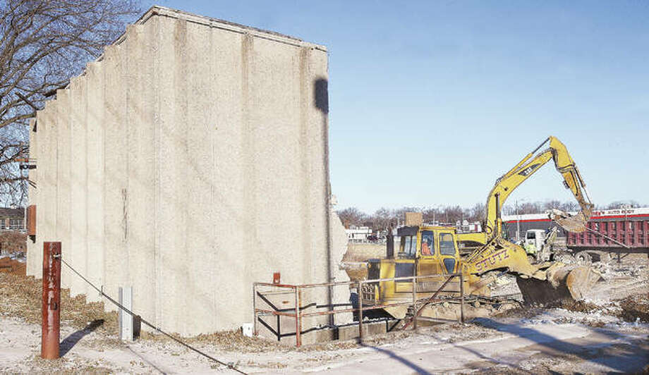 Just a portion of the rear wall of the long-closed Alton Cine in Alton was all that was left standing Wednesday morning as workers from Stutz Excavating made quick work of the demolition of the building. The theater had been closed since March 28, 1998. Photo: John Badman | The Telegraph
