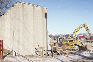 Just a portion of the rear wall of the long-closed Alton Cine in Alton was all that was left standing Wednesday morning as workers from Stutz Excavating made quick work of the demolition of the building. The theater had been closed since March 28, 1998.