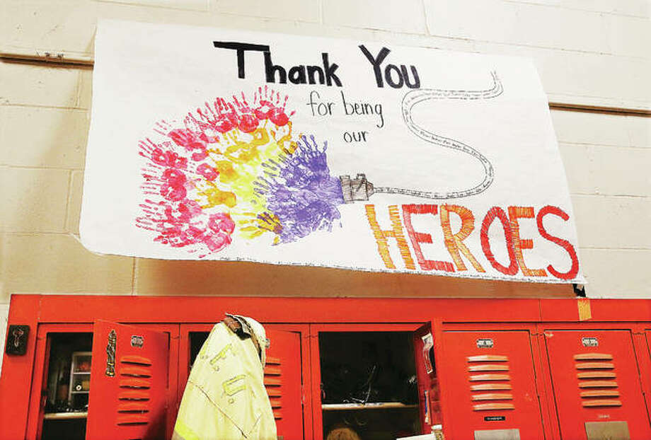 A sign, apparently made by school children, hung on the wall late Tuesday night in the East Alton Fire Station. Photo: John Badman | The Telegraph