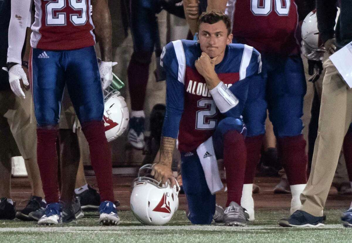 Montreal Alouettes quarterback Johnny Manziel neels on the sideline during the second half of the team's Canadian Football League game agains the Hamilton Tiger-Cats on Friday, Aug. 3, 2018, in Montreal. (Paul Chiasson/The Canadian Press via AP)