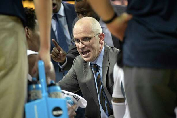UConn coach Dan Hurley, center, talks to his players during a timeout in the second half against Central Florida Thursday, Jan. 31, 2019, in Orlando, Fla.