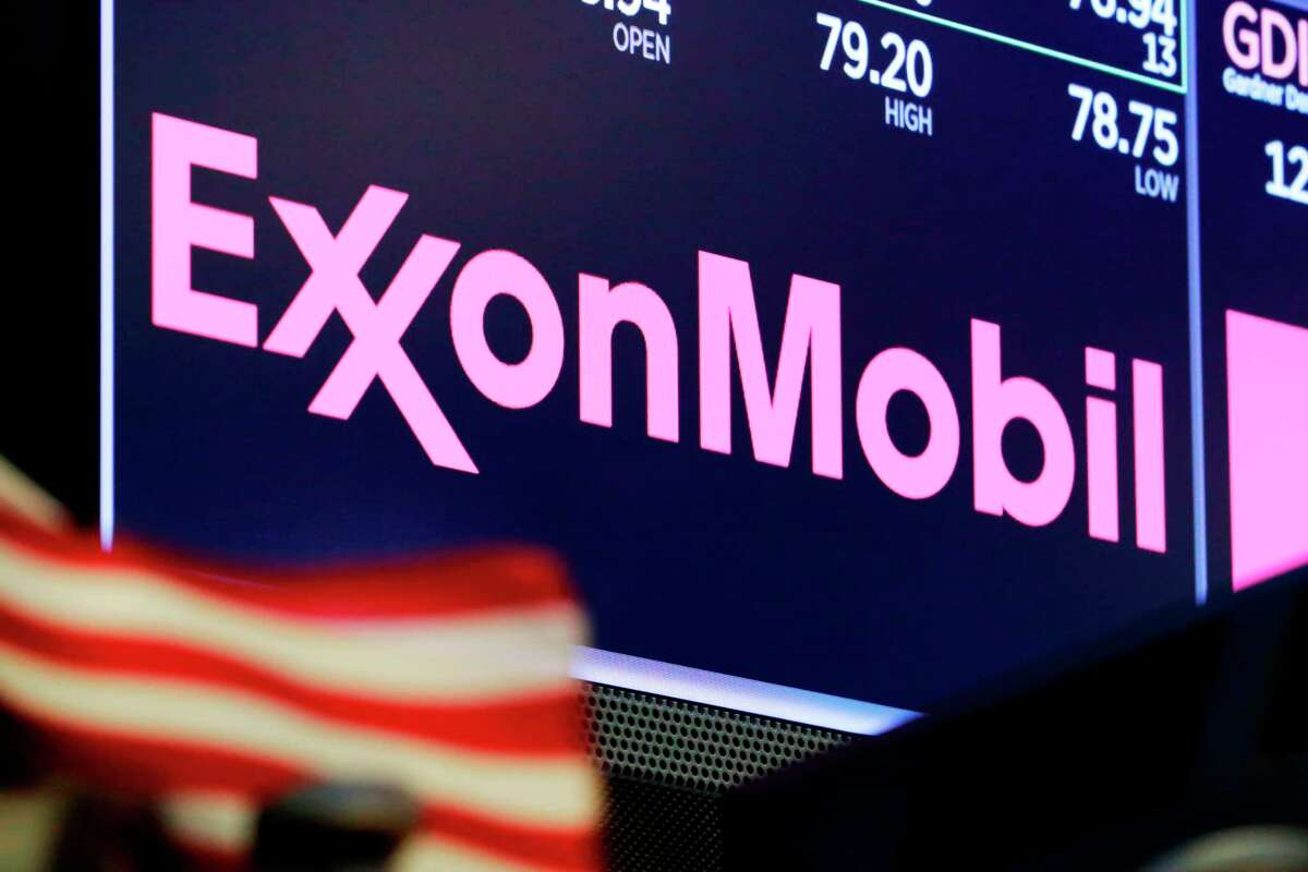 FILE - In this April 23, 2018, file photo, the logo for ExxonMobil appears above a trading post on the floor of the New York Stock Exchange. Exxon Mobil said Tuesday, March 5, 2019, that as soon as 2024 it expects to produce the equivalent of more than 1 million barrels of oil per day in the Permian Basin, which straddles western Texas and New Mexico, up from a forecast of 600,000 barrels by 2025. (AP Photo/Richard Drew, File)