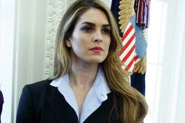 In this Feb. 9, 2018 photo, Hope Hicks appears in the Oval Office at the White House in Washington.