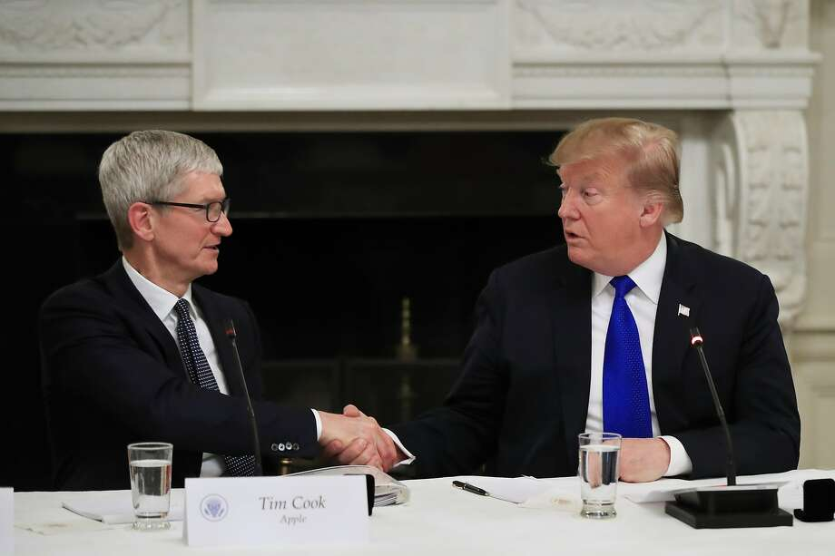 President Donald Trump shakes hands with Apple Inc. CEO Tim Cook during the American Workforce Policy Advisory Board's first meeting in the State Dining Room of the White House in Washington, Wednesday, March 6, 2019. (AP Photo/Manuel Balce Ceneta) Photo: Manuel Balce Ceneta, Associated Press