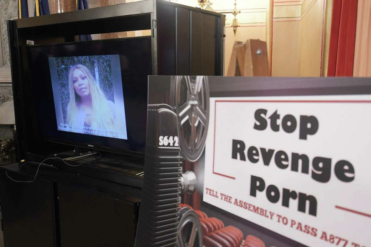 Reality television actress and singer, Teairra Mari is seen on a monitor as a recorded message she made is played during a press conference held to discuss legislation to combat revenge porn at the Capitol, June 6, 2018, in Albany, N.Y. José Menéndez works to combat revenge porn by tweaking a Senate bill in Texas.