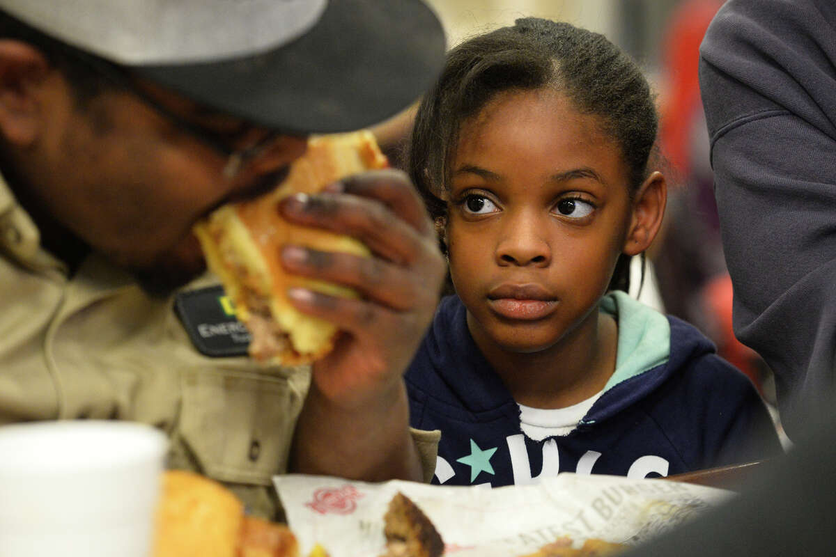 Kynnadi Ramsoure, age 8, spectates as her brother Jordon participates in a three-pound burger challenge March 6, 2019, at Fuddruckers in Midland Park Mall. Contestants attempted to eat the burger, oversize bun, and a pound of fries in one hour. James Durbin / Reporter-Telegram