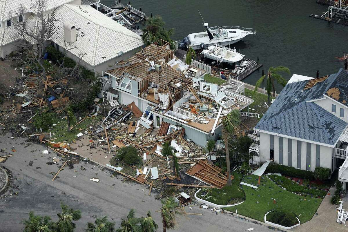 A storm-damaged Rockport, Texas home in the Key Allegro neighborhood is seen in this Sunday, Aug. 25, 2017 aerial photo. Hurricane Harvey made landfall late Friday night in Rockport as a Category 4 storm.