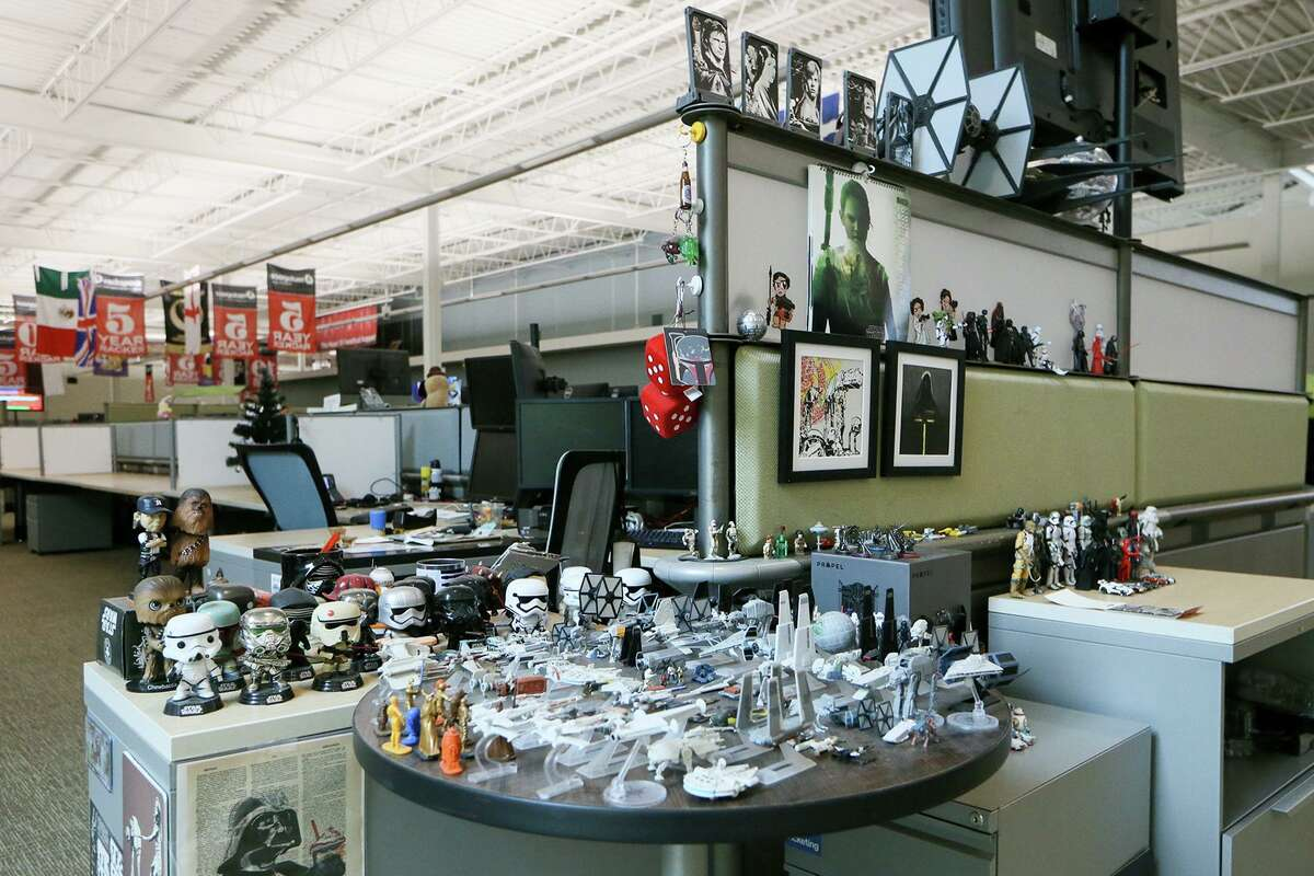 A Racker's desk decorated with Star Wars memorabilia at Rackspace on Wednesday, March 6, 2019.