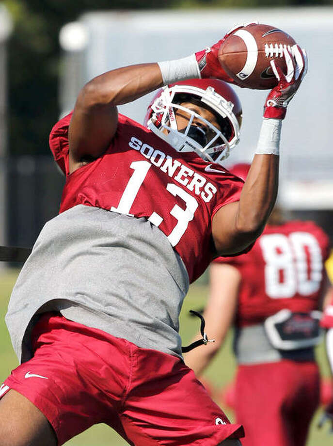 A.D. Miller (13) has decided to return to Oklahoma rather than transfer to the University of Illinois. Miller had said in January that he would leave the Sooners for the Illini. Photo: Steve Sisney, The Oklahoman