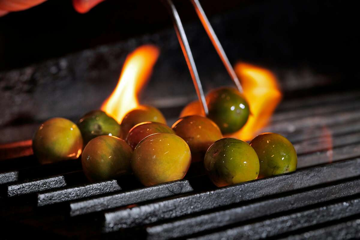 The Green Bee tomato being roasted before being served by Sabio in Pleasanton, Calif., on Thursday, January 17, 2019. The tomato is an experimental tomato developed by a local farmer and Sabio that lasts months longer than other tomatos.