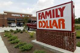 FILE - This Aug. 19, 2014 photo shows the Family Dollar store in Ridgeland, Miss. Dollar Tree is closing up to 390 Family Dollar stores this year and rebranding about 200 others under the Dollar Tree name. The company closed 84 Family Dollar stores in the fourth quarter, 37 more than originally planned. (AP Photo/Rogelio V. Solis, File)