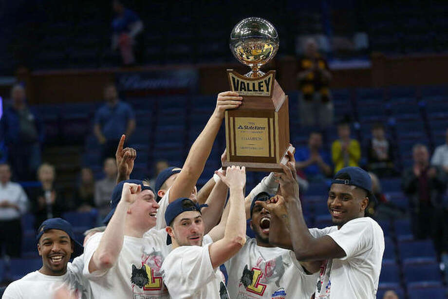 Members of the Loyola Ramblers hold the Missouri Valley Conference Champions trophy after beating the Illinois State Redbirdsto win last year's Missouri Valley Conference Basketball Tournament Championship in St. Louis. Photo: Missouri Valley