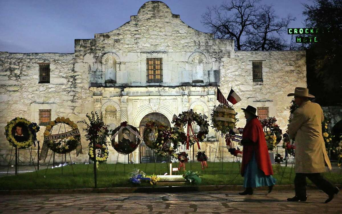 Decendants of Alamo Defenders place a wreath at the Alamo during The San Antonio Living History Association's Dawn at the Alamo, honoring those killed in the fall of the Alamo, on Wednesday, March 6, 2019, ending the annual commemoration of the 13-day siege and Battle of the Alamo.