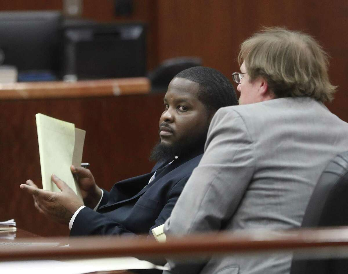 Dante Moore in court during witness testimony against Moore, who was driving a car in a chase that led to the death of a Bellaire motorcycle officer, at the Harris County Criminal Courthouse, Tuesday, March 5, 2019, in Houston.