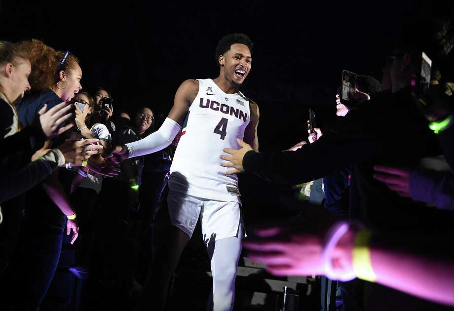 Jalen Adams is greeted by fans as he is introduced during UConn's annual First Night celebration in Storrs on Oct. 12, 2018. Photo: Jessica Hill / Associated Press / Copyright 2018 The Associated Press. All rights reserved