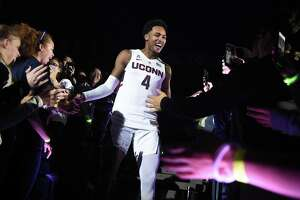 Jalen Adams is greeted by fans as he is introduced during UConn's annual First Night celebration in Storrs on Oct. 12, 2018.