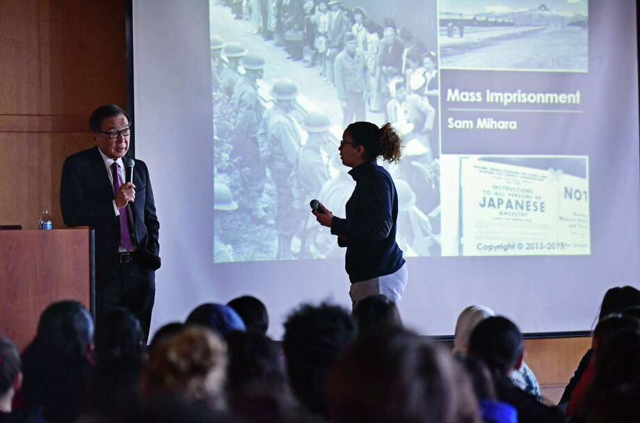 Snior Catherine Dela Cruz, right, asks a question of author and lecturer Sam Mihara while he visits Brien McMahon High School Wednesday, March 6, 2019, to speak about his life during WWII, when he and his family were forced to move from their home in San Francisco to a Japanese internment camp in Wyoming, during a presentation at the Center for Global Studies in Norwalk, Conn. Photo: Erik Trautmann / Hearst Connecticut Media / Norwalk Hour