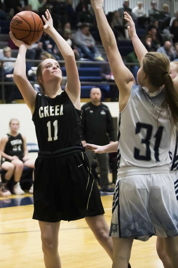 Bullock Creek's Sydney Borsenik takes a shot during the Lancers' Division 2 district semifinal against Bay City John Glenn on Wednesday, March 6, 2019 at John Glenn High School. (Katy Kildee/kkildee@mdn.net) Photo: (Katy Kildee/kkildee@mdn.net)