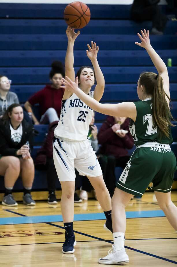 Meridian's Jenna Holzinger passes to a teammate during the Mustangs' Division 3 district semifinal against Pinconning on Wednesday, March 6, 2019 at Meridian Early College High School. (Katy Kildee/kkildee@mdn.net) Photo: (Katy Kildee/kkildee@mdn.net)