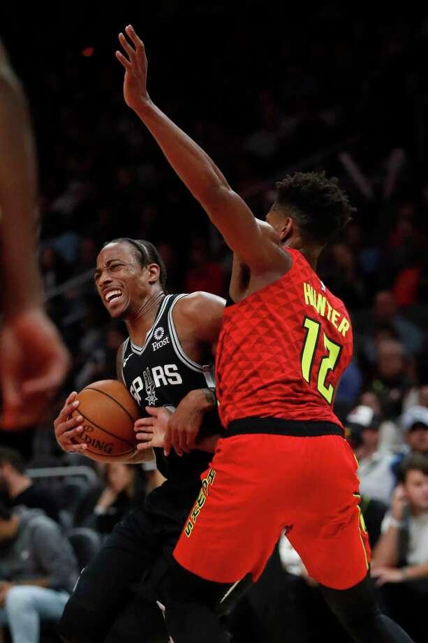 San Antonio Spurs guard DeMar DeRozan (10) works the floor against Atlanta Hawks forward Taurean Prince (12) during the first half of an NBA basketball game, Wednesday, March 6, 2019, in Atlanta. (AP Photo/John Amis) Photo: John Amis, Associated Press / FR69715 AP