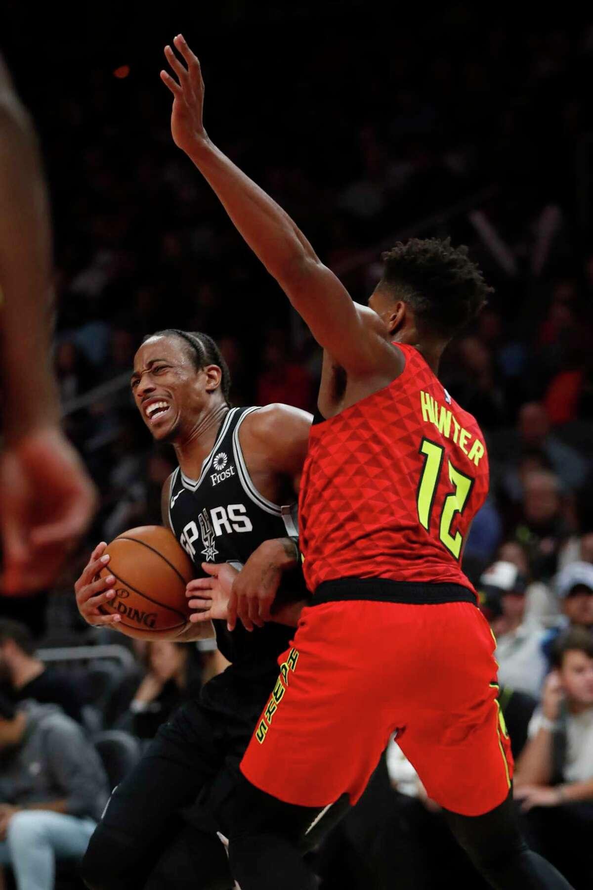 San Antonio Spurs forward DeMar DeRozan (10) drives against Atlanta Hawks forward De'Andre Hunter (12) in the first half of an NBA basketball game Tuesday, Nov. 5, 2019, in Atlanta. (AP Photo/John Bazemore)