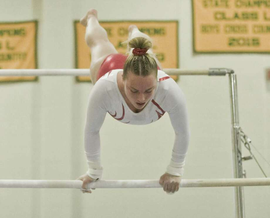 Elizabeth Marino, of Greenwich High School, competes on the bars during the State Open gymnastics championships at New Milford High School. For story and photos visit www.greenwichtime.com/sports. Photo: Scott Mullin / For Hearst Connecticut Media / The News-Times Freelance