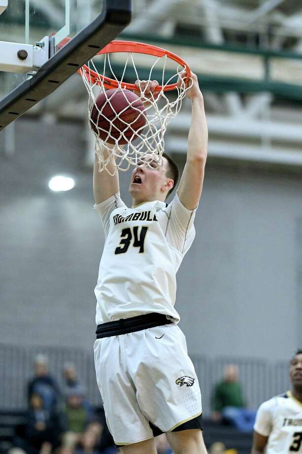 Trumbull's Evan Gutowski dunks against Hamden on Wednesday, March 6, 2019 during a second-round CIAC Division I boys basketball game at the Floyd Little Athletic Center in New Haven, Conn. Photo: David G. Whitham / For Hearst Connecticut Media / Stamford Advocate Freelance