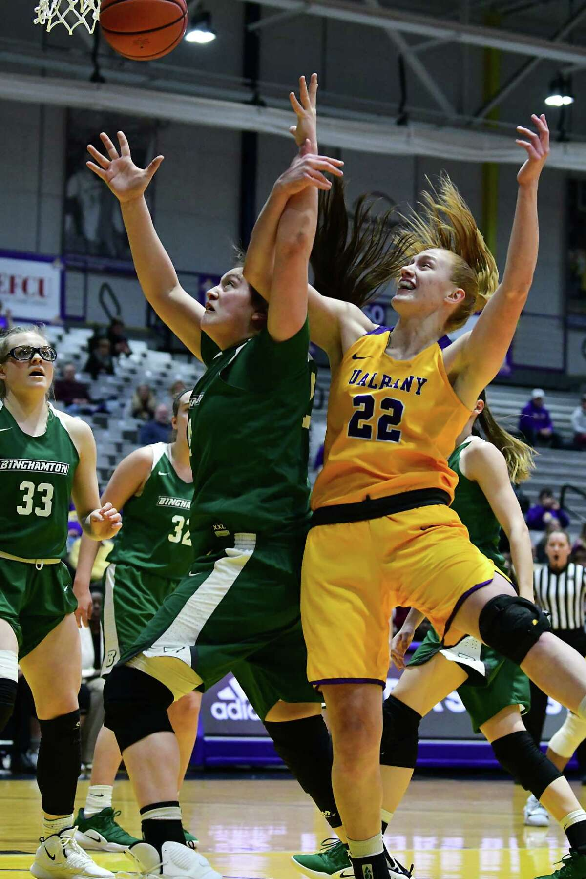 Binghamton's Olivia Ramil, left, and University at Albany's Heather Forster battle for a rebound during a basketball game at the SEFCU Arena on Wednesday, March 6, 2019 in Albany, N.Y. (Lori Van Buren/Times Union)