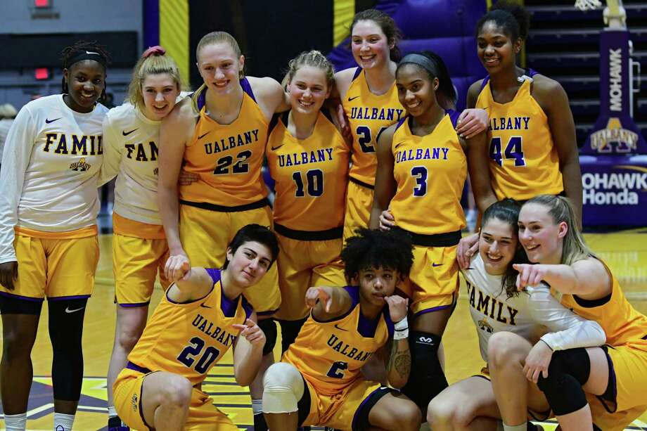 University at Albany players pose for a photo after defeating Binghamton during an America East Conference tournament game at SEFCU Arena on Wednesday, March 6, 2019 in Albany, N.Y. (Lori Van Buren/Times Union) Photo: Lori Van Buren / 20046314A
