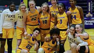University at Albany players pose for a photo after defeating Binghamton during an America East Conference tournament game at SEFCU Arena on Wednesday, March 6, 2019 in Albany, N.Y. (Lori Van Buren/Times Union)