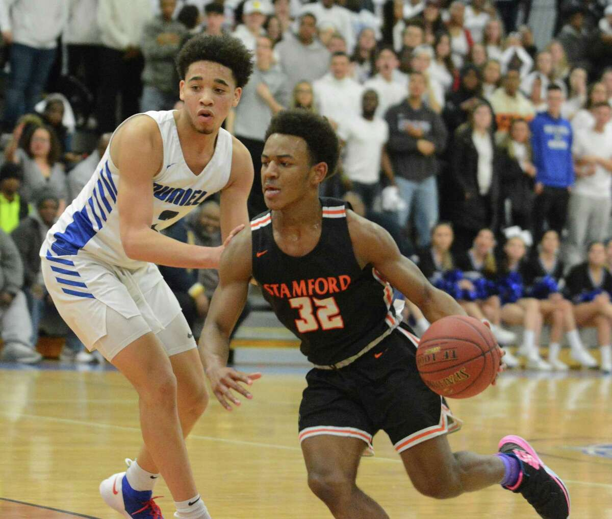 Stamford's Jaden Bell (32) dribbles past Bunnell's Max Edwards (2) during a CIAC Division II boys basketball game on Wednesday, March 6, 2019 in Stratford, Conn.