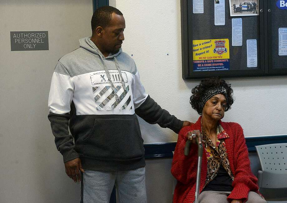 Andre Molo consoles his mother Paula Singleton after they and other family members of Shayne Lyons, who was fatally shot by a Port Arthur police officer in December, gather in the lobby of the Port Arthur Police Department after reviewing the body cam footage from the night of the incident. Photo taken Wednesday, March 6, 2019 Kim Brent/The Enterprise Photo: Kim Brent / The Enterprise / BEN