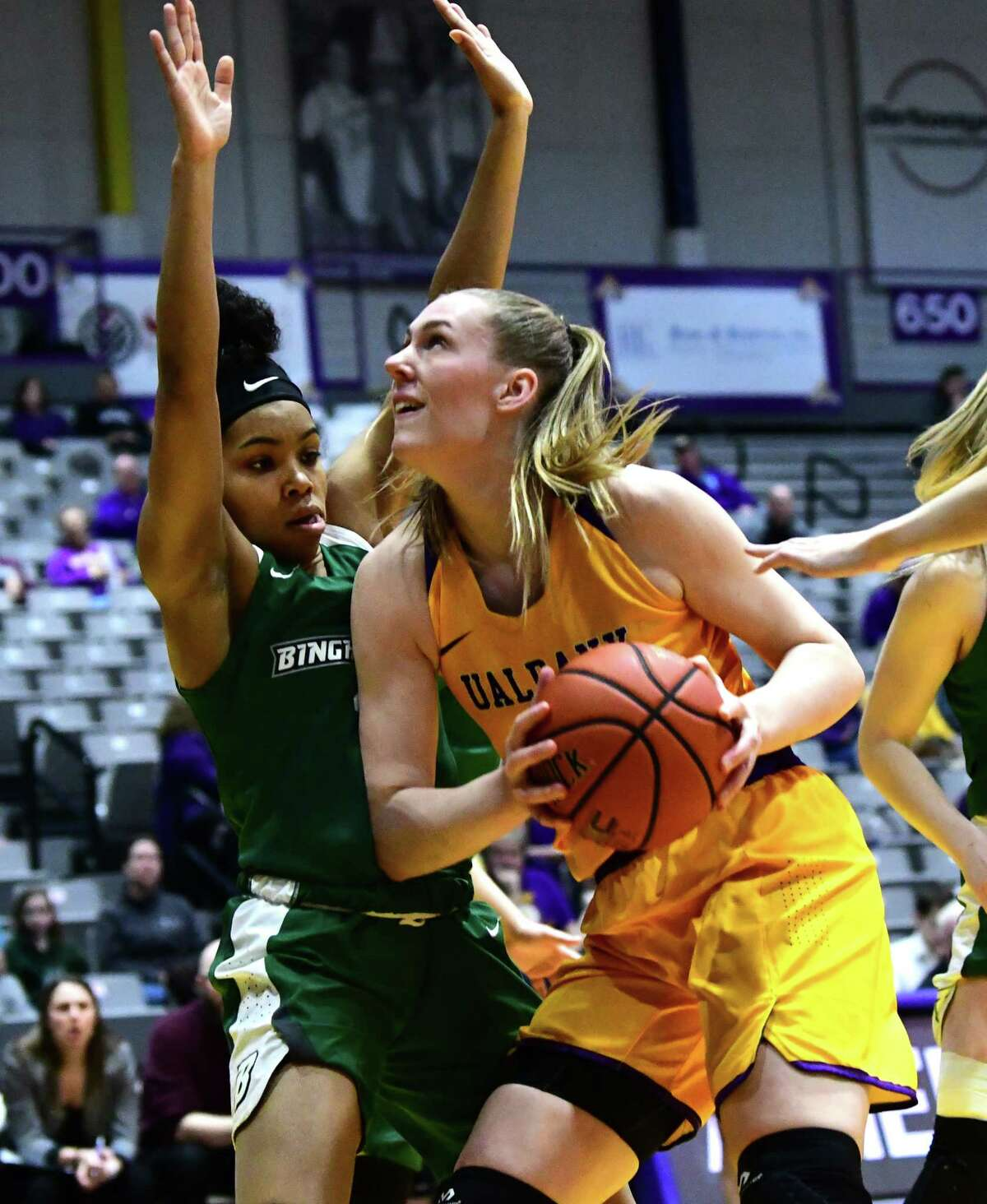 University at Albany's Amanda Kantzy drives to the net against Binghamton's Kai Moon during a basketball game at the SEFCU Arena on Wednesday, March 6, 2019 in Albany, N.Y. (Lori Van Buren/Times Union)