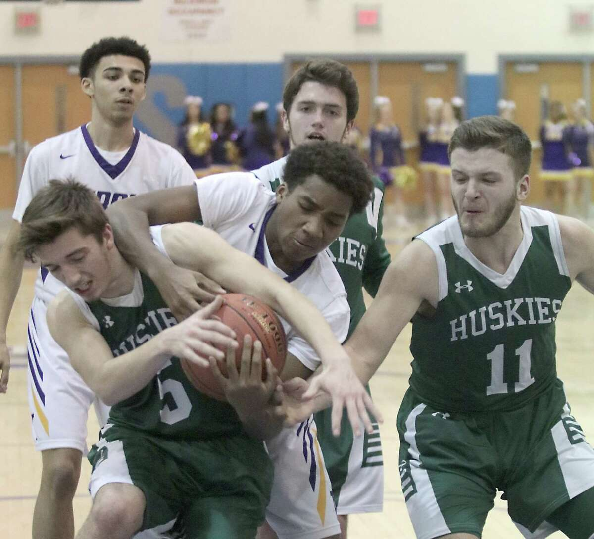 Franklin's Hunter Swan battles for possession with Troy's Jadon Cummings during the Class A state regional basketball playoff game at Saratoga Springs High School Wednesday, March 6, 2019. (Ed Burke photo-Special to The Times Union)